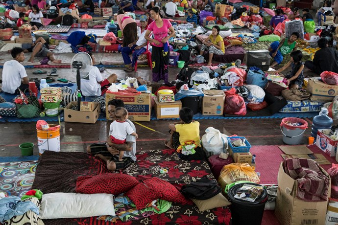 Thousands of evacuees seek shelter.