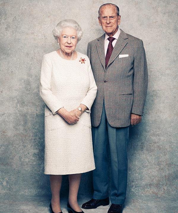 The Queen's left elbow edges towards her husband, indicating she wants him close by.