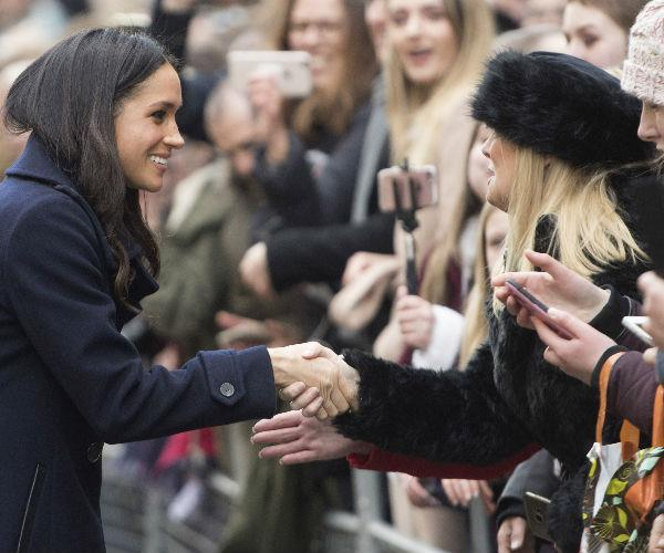 """Adorably, she made a point of introducing herself to waiting crowds, saying: """"Hi, I'm Meghan!"""""""