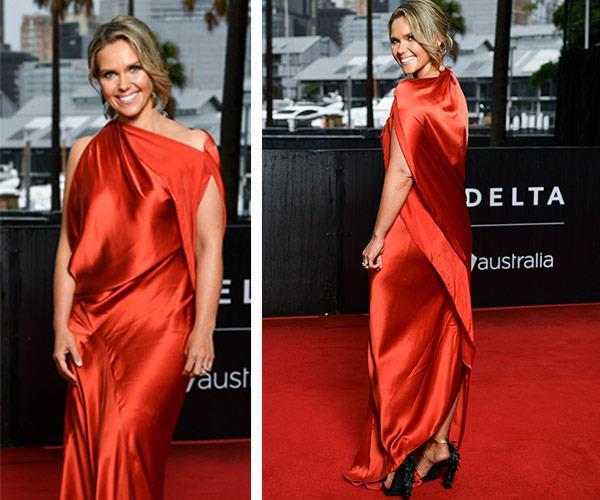 Sunrise's Edwina Bartholomew stuns in this blood-orange silk dress by Bianca Spender.