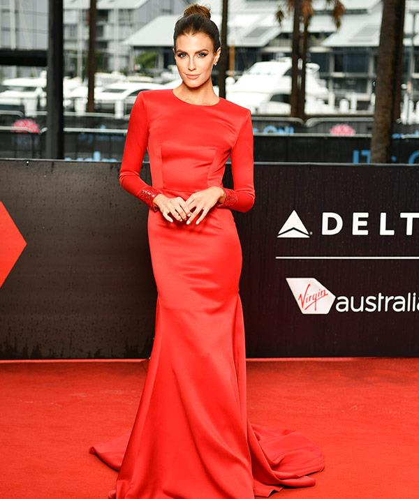 Presenter and former Miss World Australia star Erin Holland oozes elegance in this custom-made BronxandBanco red gown.