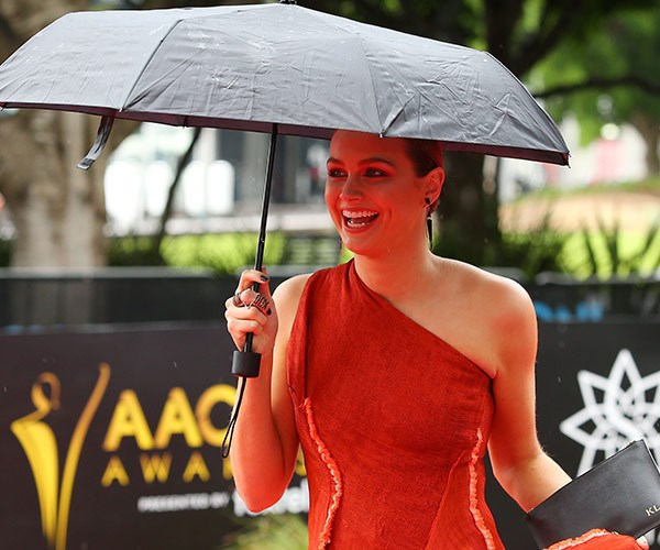 It's not raining on Ksenija's parade! The 27-year-old made sure she had her best accessory on hand - a brolly!