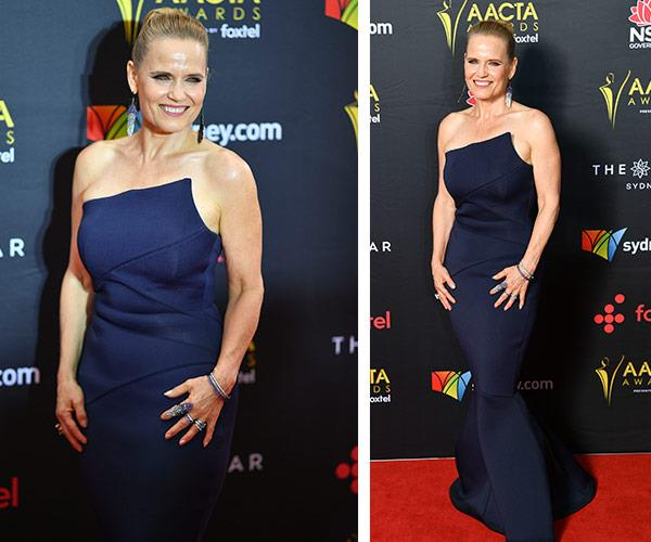 The Block beauty Shaynna Blaze is winning major style points in this figure-hugging, strapless navy creation.