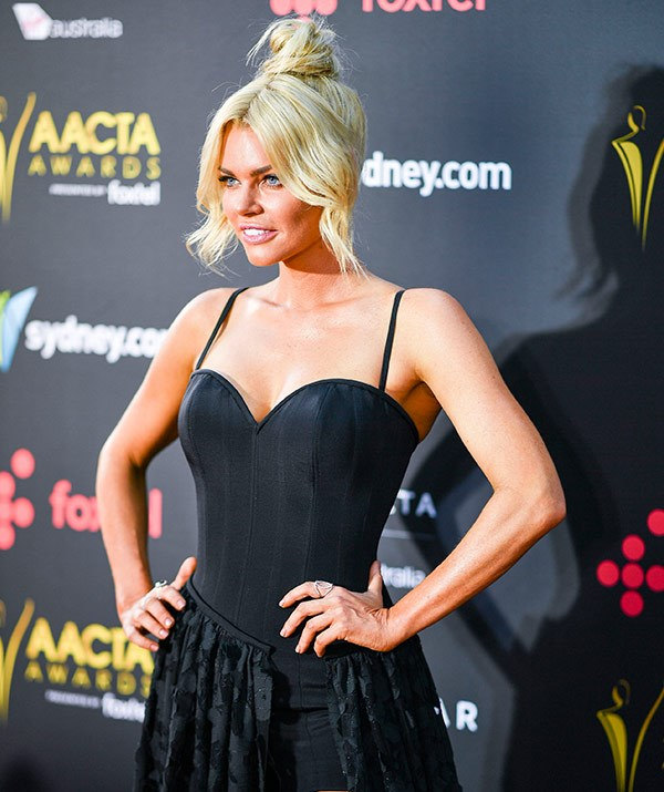 *The Bachelorette* beauty walked the red carpet sans Stu Laundy and onlookers tell us the 37-year-old spoke to one media outlet before changing her mind and heading inside to avoid the rest of the press pack.