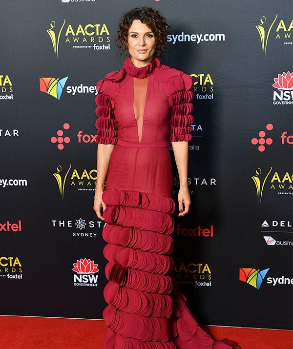 Wentworth's Danielle Cormack packs a punch in this burgundy frock.