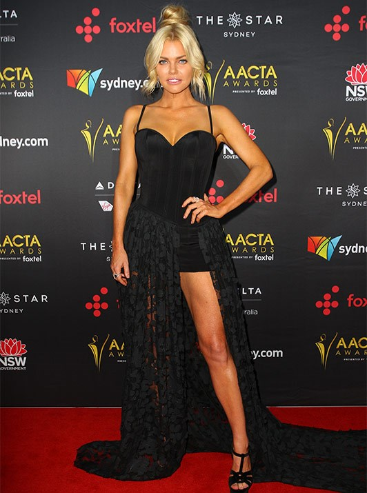 Bronzed babe: Soph has never shied away from the fake tan and it was no exception for the AACTAs.