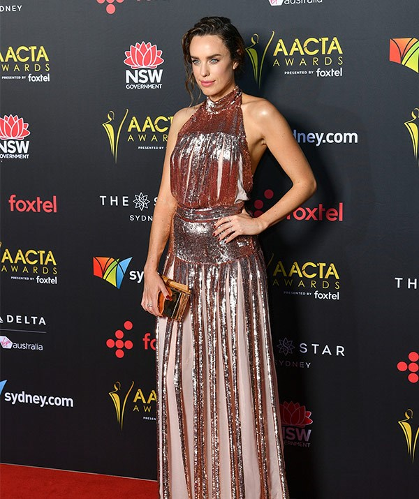 While her sister Jessica McNamee shines bright in a metallic number.