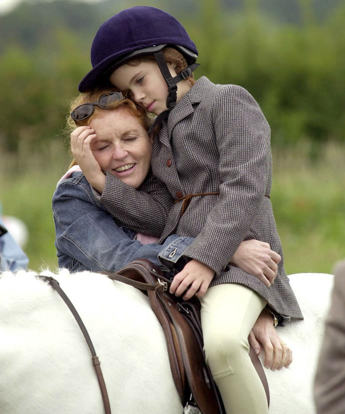 The mother-daughter duo are pictured cuddling at a horse show in the south of England.