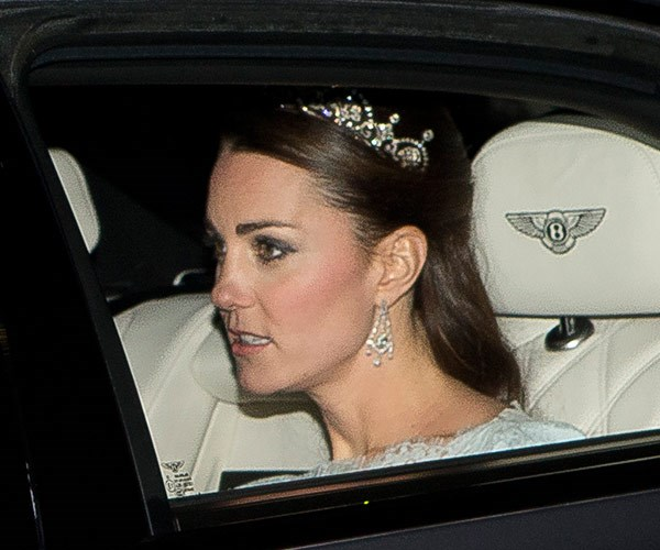 She teamed the look with chandelier-style drop earrings. *(Image: Splash)*
