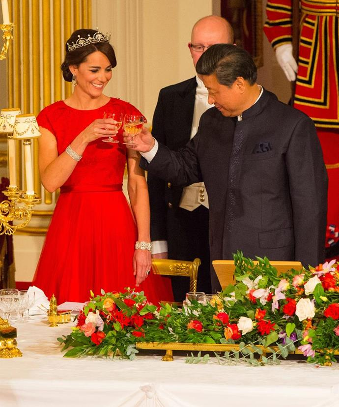 The royal's glittering headpiece was teamed with a bright red Jenny Packham gown. *(Image: Getty)*
