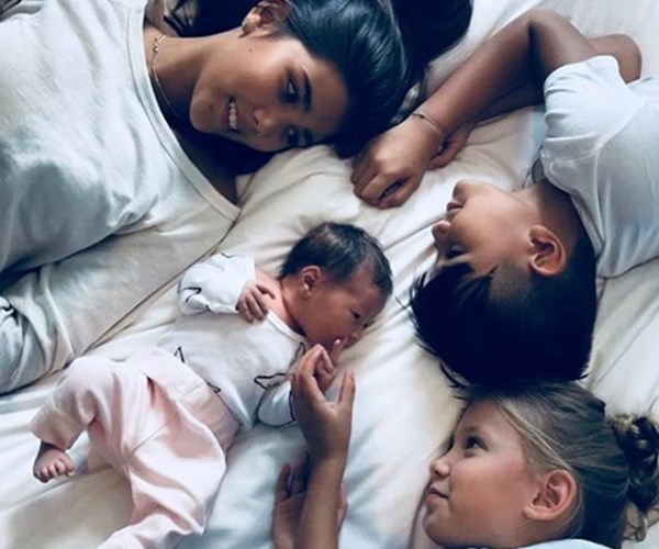 """When 3 become 4! Now life is complete,"" Lindy wrote alongside this stunning shot of her growing family which includes, Stella, 11, Frankie, six, Rocco, nine, who she shares with ex-husband, Michael Klim and week-old Goldie, her first child with fiancé Adam Ellis."
