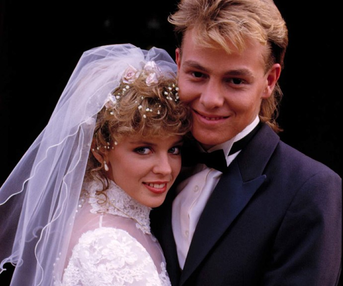 **Scott and Charlene have the TV wedding of the century:** Crazy in love couple Scott (**Jason Donovan**) and Charlene (**Kylie Minogue**) had their iconic wedding in 1987. The two made it to the altar after a rocky relationship due to their family's feuding. Their romantic church ceremony became one of the most watched TV moments of the decade.