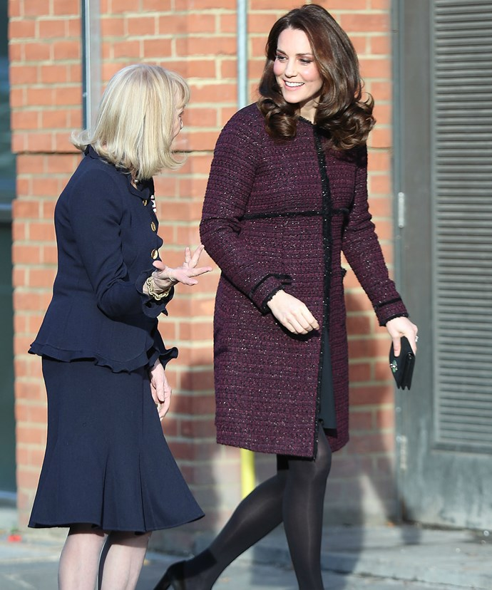 Kate, who is expecting her third child in April, concealed her growing baby bump under a burgundy coloured coat dress by Seraphine.