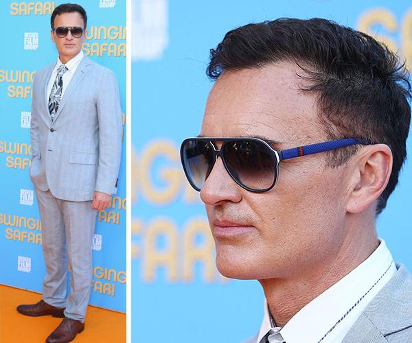 Let's just take a moment to appreciate Julian McMahon's entire get-up. How cool are his retro blue sunnies?