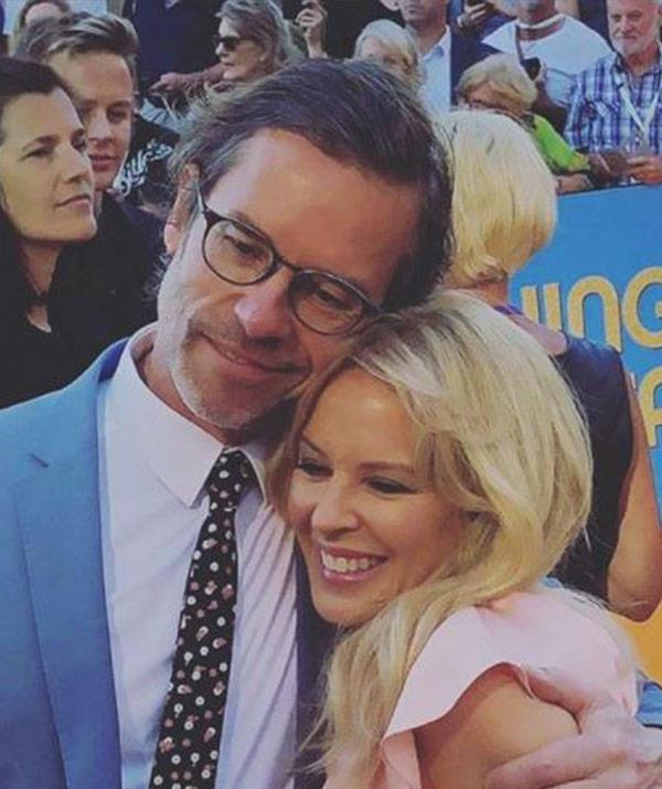 To this! Another adorable hug, just many years later on the red carpet for *Swinging Safari*.