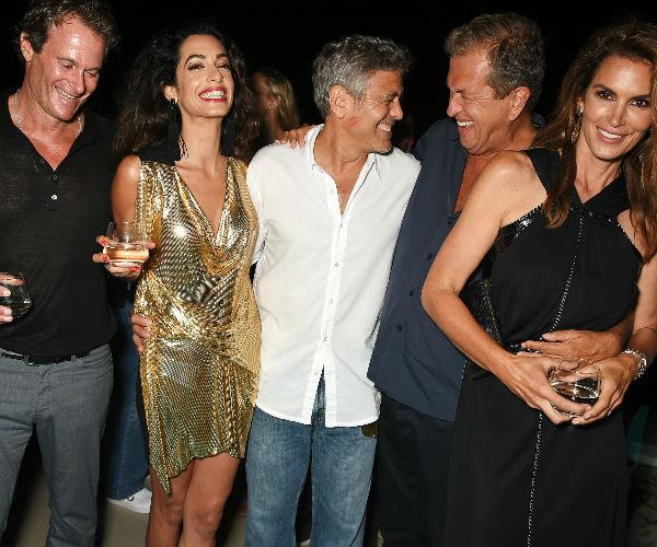 George (C) is pictured here with Rande Gerber, wife Amal, photographer Mario Testino and Cindy Crawford (L-R).