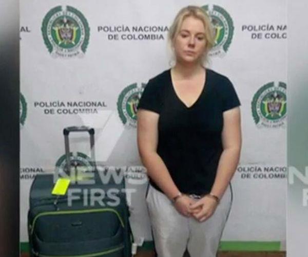 The convicted drug smuggler is pictured alongside her luggage, just hours after her arrest.