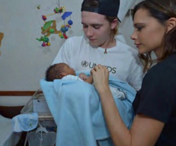 "Victoria and David do their best to teach their children good values by using their privilege to benefit others. ""I am so proud to be able to share these experiences with my son @brooklynbeckham and have him join me in supporting @newlifehomeke on my field trip."" Here Victoria and Brooklyn pay a visit to a hospital with Unisef."