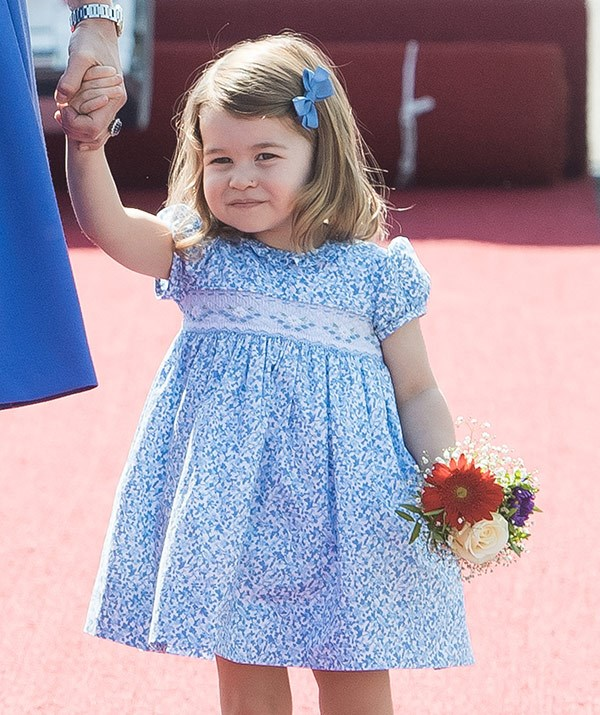 Just like mummy, Charlotte recycled this glorious sun dress.