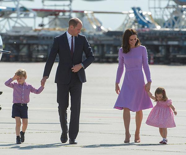 Prince George and Prince William hold hands, while Kate takes charge of Charlotte.