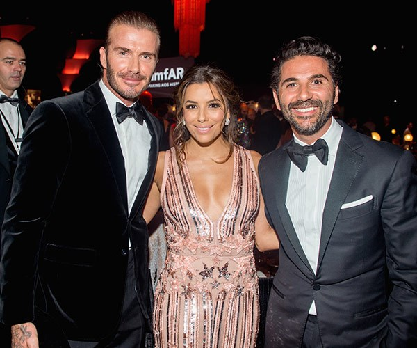 The couple, pictured with their dear friend David Beckham, are expecting a son.