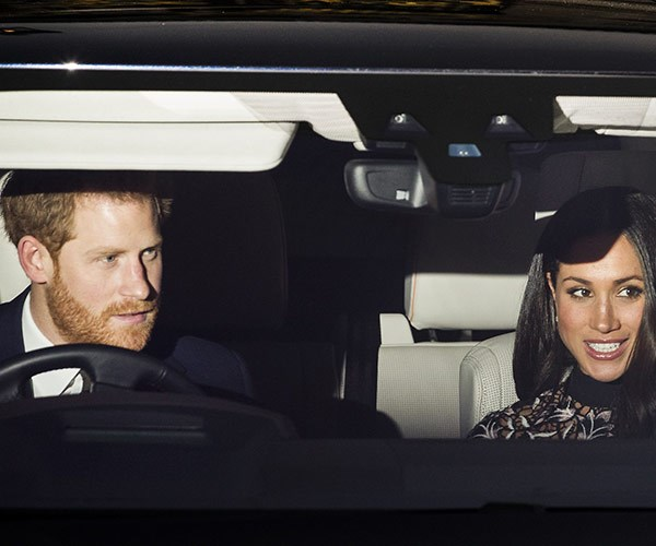 You can only see the black-and-white-laced detailing of Meghan's Self-Portrait dress...