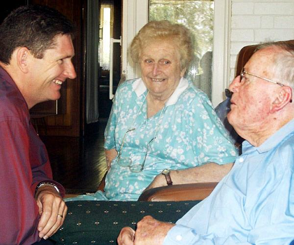 """The charming former fist lady, pictured with Queensland's opposition leader Lawrence Springborg and former Queensland Premier Sir Joh in 2003, says she thought her husband was a """"handsome devil""""."""
