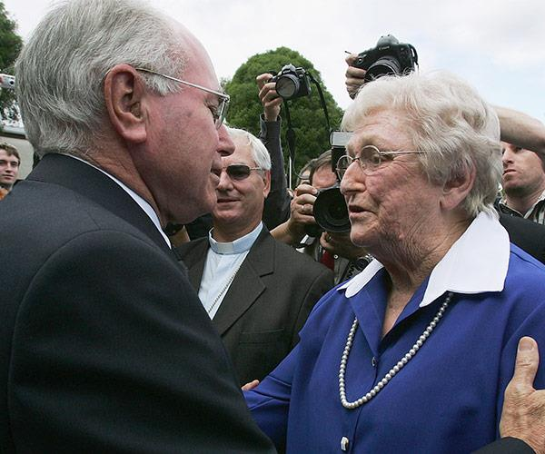 Our then-Prime Minister John Howard comforts Florence at her husband's funeral in 2005.