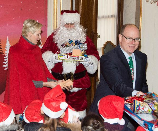 The duo played Santa at the festive event as they personally handed each child a gift.