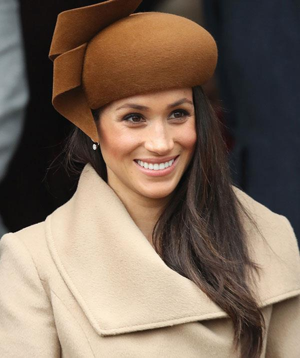 Meghan went with warm tan hues for the chilly winter's day.