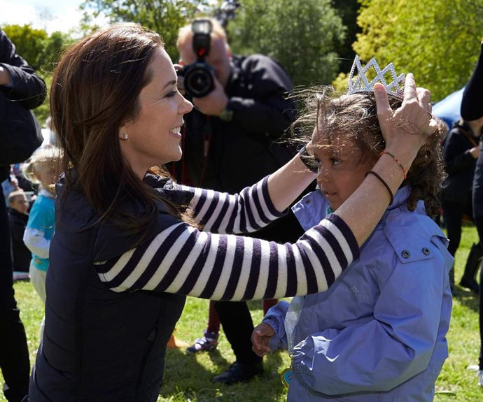 Crown Princess Mary presents a little girl with a crown in the spirit of anti-bullying, June 2015