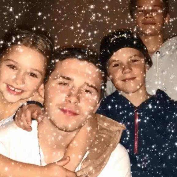Hinting the family where enjoying Christmas in a wintry location, Victoria posted this sweet snap of her adorable children, using a snowflake filter.