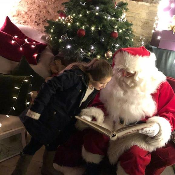 The Beckham kids must have been good this year! Santa dropped in on the family and checked their names were on his good list.