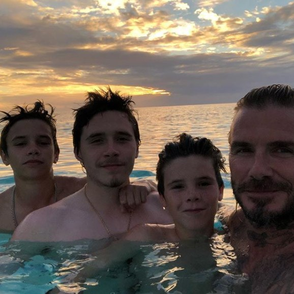 """Sunset with my beautiful boys,"" dotting dad David captioned this selfie of the Beckham boys Romeo, Brooklyn and Cruz while on family holiday."