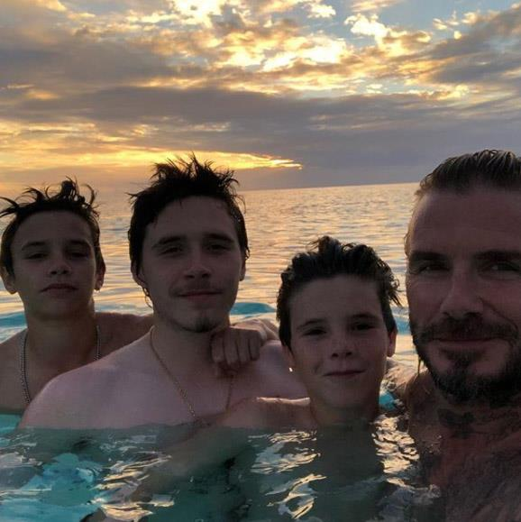 Family Enjoying Time Together On Beautiful Foggy Beach: The Beckhams Are Having Their Best Family Holiday Yet