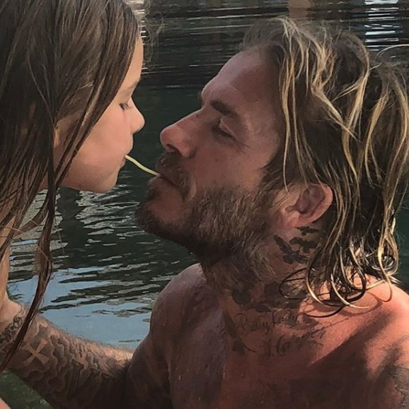 "Former star footballer, David Beckham, posed with his youngest child, Harper, pretending to share a piece of spaghetti as they re-enacted the memorable scene from Disney film *Lady And The Tramp*. The sweet father-daughter moment was captured by proud mum Victoria, who posted it to Instagram with the caption: ""The best daddy in the world x We Love u so so much. Kisses."""