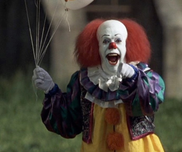 "**Pennywise The Clown - *It***  Years before the most recent adaptation of **Stephen King'**s *It* terrified cinema audiences and made a killing at the box-office, there was a mini-series version of the prolific author's epic tome. Lurking in the nightmares of a group of outcast kids who called themselves ""The Loser Club"", Pennywise, played by *Rocky Horror Picture Show* star **Tim Curry**, is an unnerving creation who returns every 28 years to prey on the fears and kill the inhabitants of a small town called Derry."