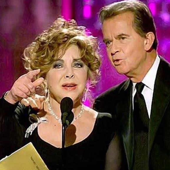 "**Elizabeth Taylor forgets award show etiquette.** Speculation swirled that Elizabeth Taylor had enjoyed a cocktail or 10 before she appeared on the 2001 Golden Globes stage to announce the final award of the night. The Hollywood icon struggled to read the teleprompter while announcing the ""Golden Glow"" nominees before tearing into the envelope ahead of time. ""What is this for?"" Elizabeth hilariously asked of the envelope. Show producer, Dick Clark rushed to her side to help the glamorous star.""I guess I'm more used to receiving awards rather than giving them,"" she quipped."