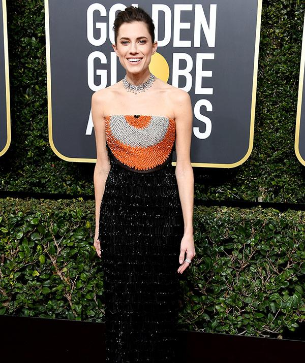 *Girls* fave Allison Williams gives her strapless number a pop of colour with orange detailing.