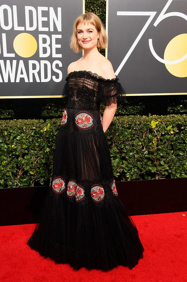 Alison Sudol boho black gown with red detailing gets a resounding thumbs up from us.