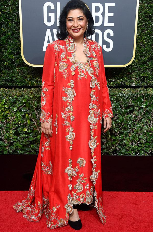 Not embracing the black! Meher Tatna, the president of the Hollywood Foreign Press Association opted for a bright red dress and overcoat.