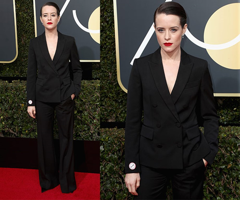 Suit up! Claire Foy looks a million miles away from her altar ego, Queen Elizabeth.