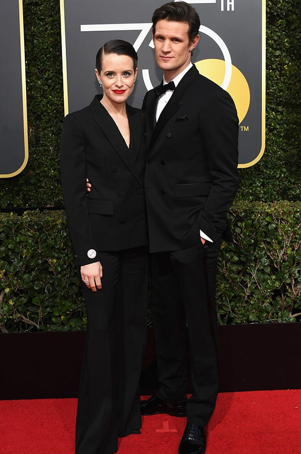 Lizzie and Phil off duty! *The Crown*'s Claire Foy and Matt Smith share a warm embrace.
