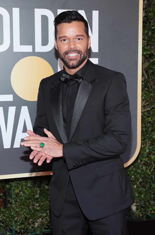 Ricky Martin rocks an all-black tux and a bright green ring.