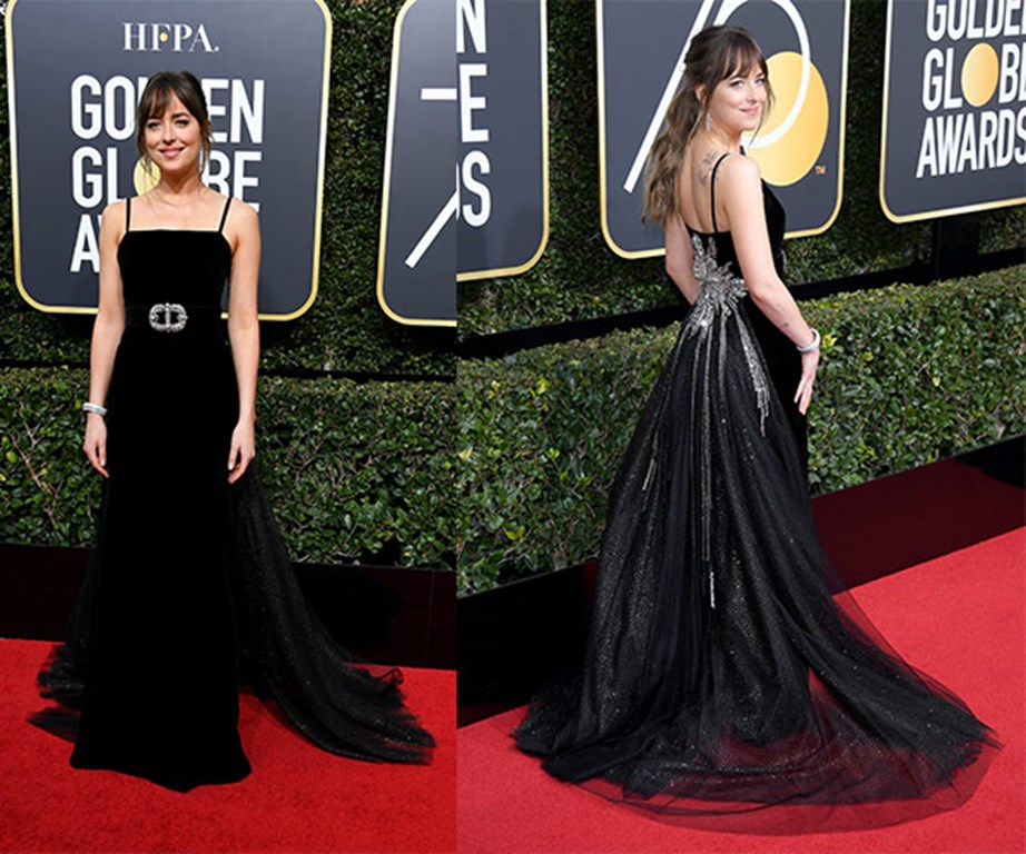 Despite her blossoming new romance with Chris Martin, Dakota Johnson walked the red carpet solo.