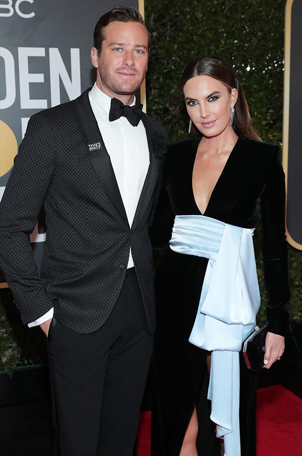 Lone Ranger no more, travelling-as-a-twosome Armie Hammer cuts a cool, classic red-carpet look, while his wife, Elizabeth Chambers, is all wrapped up in this black-and-white delight. Because two ridiculously good-looking celebs are better than one...