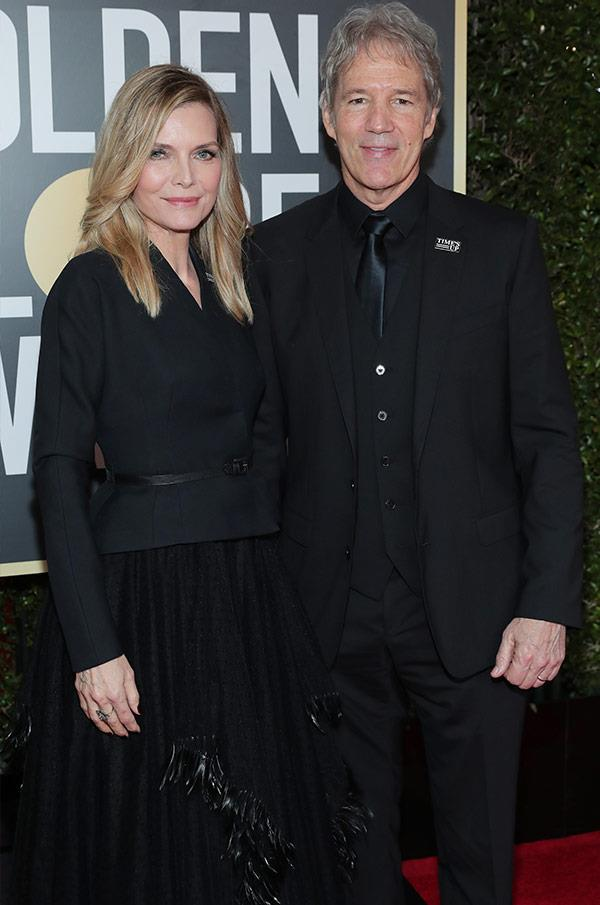 What lies beneath Michelle Pfeiffer and David E. Kelley's long-lasting love, evident here on the Golden Globes red carpet? A relationship that's survived almost THREE DECADES - oh, *and*, y'kow, a murder on the Orient Express...
