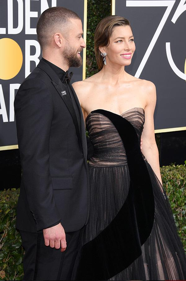 There ain't no sinner here; Jessica Biel is red-carpet perfection in this textured, strapless floor-sweeper. As for Justin Timberlake? Well, as long as he has his suit and tie (*and* his award-nominated wife, by his side), his Golden-Globes garb is totally Justified...