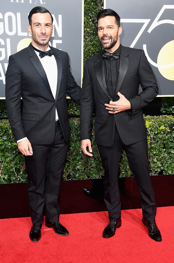 Tressed to impressed, Ricky Martin and his partner, Jwan Yosef, are livin' La Vida Loca-ing up the red carpet in jet-black style. Their matching manes are almost as sleek, chic and shiny as the Golden-Globe statuettes, themselves!