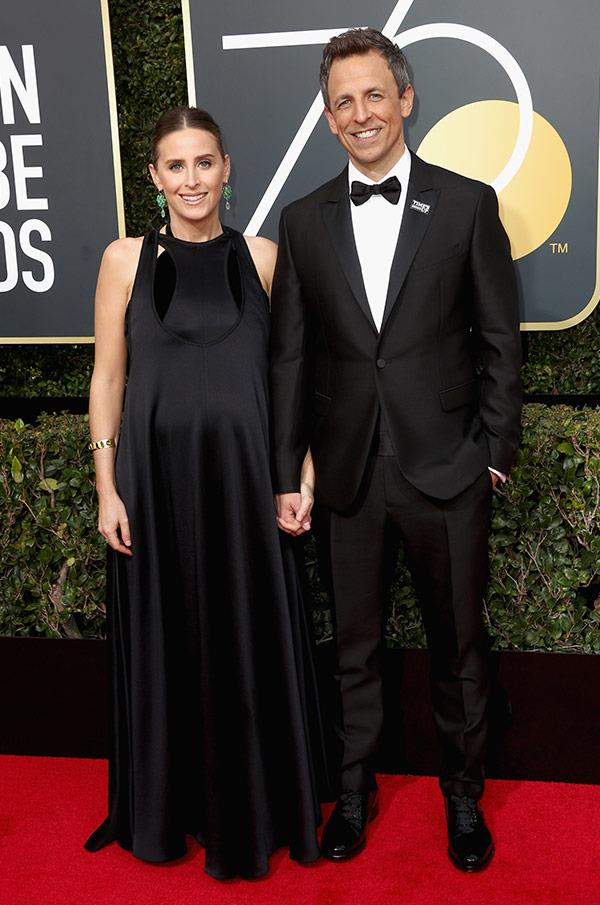 BUMP ALERT! Golden Globes' host Seth Meyers and his wife, Alexi Ashe, look proud as punch to be expecting their second bundle of joy. Ditto, you two...